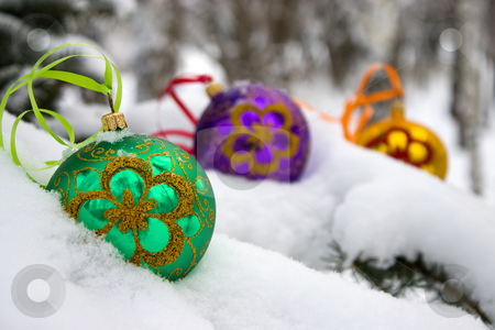 Christmas-tree. stock photo, Three color christmas baubles sitting in a bed of snow. by Yury Ponomarev