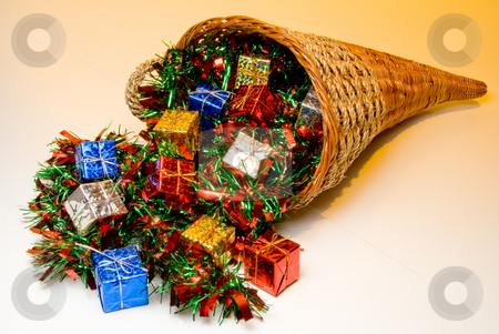 Cornucopia stock photo, A cornucopia filled with holidat Christmas presents. by Robert Byron