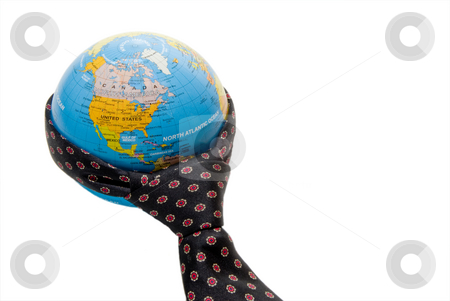 Business World stock photo, A necktie wrapped aroung a globe of the world. by Robert Byron