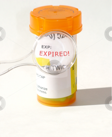 Expired Pills stock photo, An expired bottle of prescription pills magnified. by Great Divide Photography