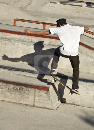 Jumping skateboarder stock photo, Skateboarder jumping in a skateboard park by Dunja Bond