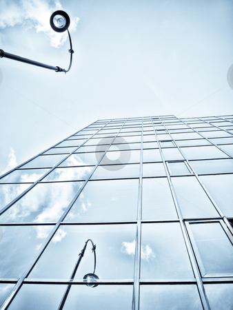 Blue office building stock photo, Blue office building with clouds ans lamp post reflection by Laurent Dambies