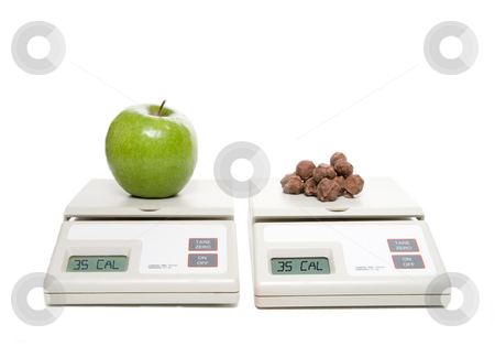Healthy Choice stock photo, A scale with an apple and one with chocolate. by Robert Byron