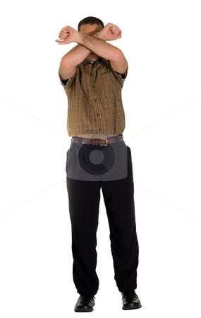 On Guard stock photo, Full body view of a man raising his arms in front of his face in a defensive position, isolated against a white background by Richard Nelson