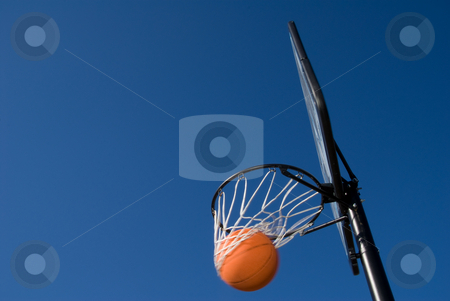 Basketball Goal stock photo, A basketball and goal waiting for a game to start. by Robert Byron