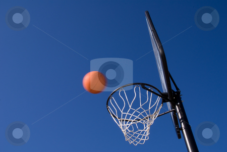 Basketball  stock photo, A basketball and goal waiting for a game to start. by Robert Byron