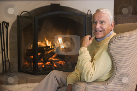 Man in living room smiling stock photo,  by Monkey Business Images