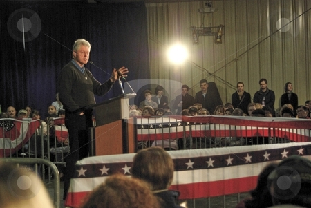 Popular former president stock photo, Bill Clinton still draws crowds whenever he makes a public appearance.  During the 2008 presidential election process he campaigned for his wife and also for Barack Obama, the next president. by Dennis Thomsen