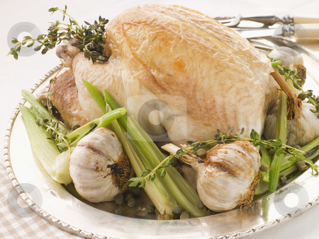 40 Clove of Garlic Roasted Chicken with Baby Spring Vegetables stock photo,  by Monkey Business Images