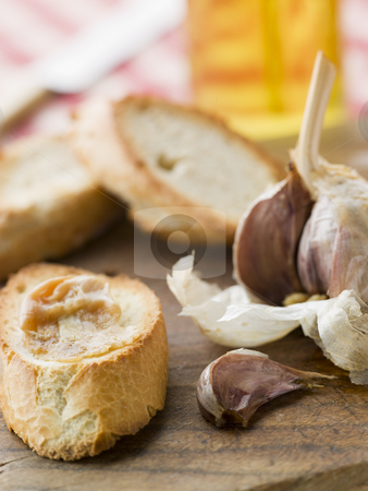 Cloves of Roasted Garlic spread on Toasted baguette stock photo,  by Monkey Business Images