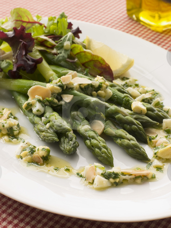 Asparagus Spears with Polonaise Vinaigrette and Salad Leaves stock photo,  by Monkey Business Images