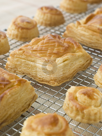 Selection of Vol au vents on a Cooling rack stock photo,  by Monkey Business Images