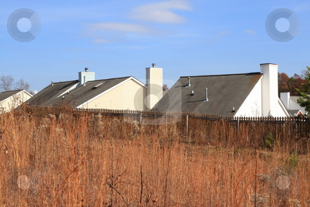 Rooftops stock photo, Rooftops of housing community on a clear bue sky by Jack Schiffer