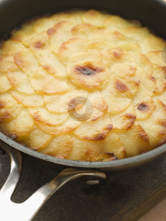 Pomme Anna Cake in a Frying Pan stock photo,  by Monkey Business Images