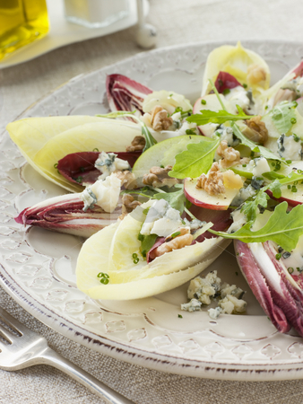 Salad of Chicory Walnuts and Apple with Roquefort Vinaigrette stock photo,  by Monkey Business Images