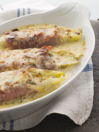 Dish of Chicory Gratin with Bacon stock photo,  by Monkey Business Images