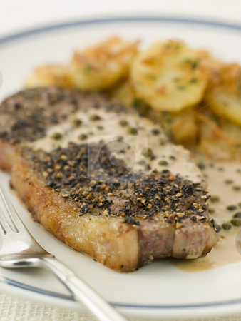 Steak au Poirve' with Saut Potatoes stock photo,  by Monkey Business Images