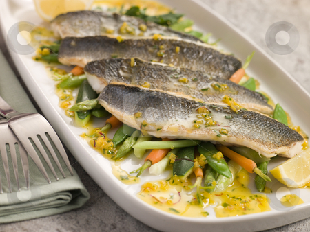 Fillets of Sea bass with Baby Vegetables and Saffron Butter stock photo,  by Monkey Business Images