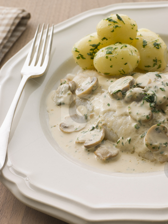 Whole Dover Sole Bonne Femme with pomme nouvelle stock photo,  by Monkey Business Images