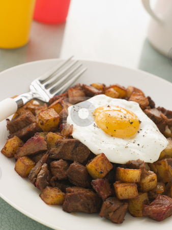 Corned Beef Hash With a Fried Egg and Black Pepper stock photo,  by Monkey Business Images