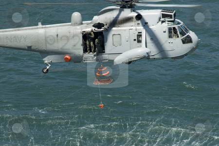 Navy rescue chopper stock photo, A royal Australian navy rescue helicopter performing a public rescue demonstration for Australia day by Stephen Gibson