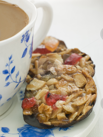 Petit Florentines with a Cup of Tea stock photo,  by Monkey Business Images