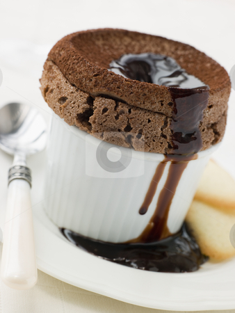Hot Chocolate Souffle with Chocolate sauce and Langue de Chat Bi stock photo,  by Monkey Business Images