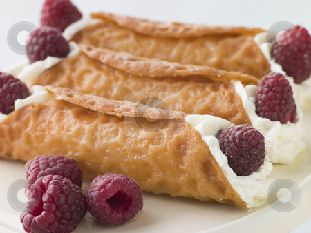 Cream Brandy Snaps with Raspberries stock photo,  by Monkey Business Images