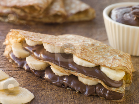Crepes filled with Banana and Chocolate Hazelnut Spread stock photo,  by Monkey Business Images