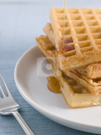 Waffles with Caramel Syrup stock photo,  by Monkey Business Images