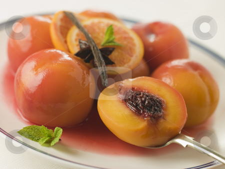 Bowl of Peaches Poached in Sauternes Wine stock photo,  by Monkey Business Images