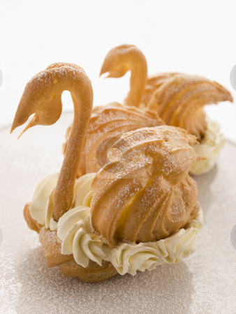 Two Choux Swans filled with Chantilly Cream stock photo,  by Monkey Business Images