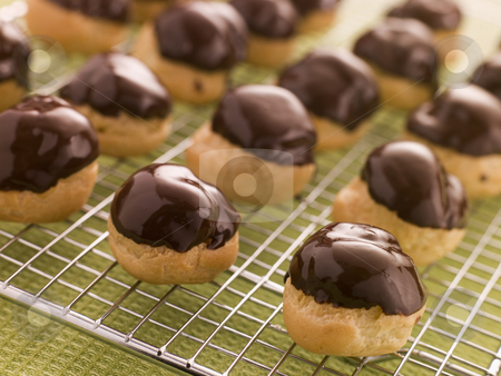 Chocolate dipped Profiteroles stock photo,  by Monkey Business Images