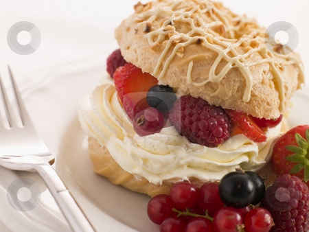 Choux Bun filled with Mixed Berries and Chantilly Cream stock photo,  by Monkey Business Images