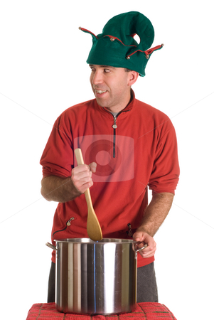 Sneaky Elf stock photo, A sneaky elf stirring something into a pot of soup, isolated against a white background by Richard Nelson