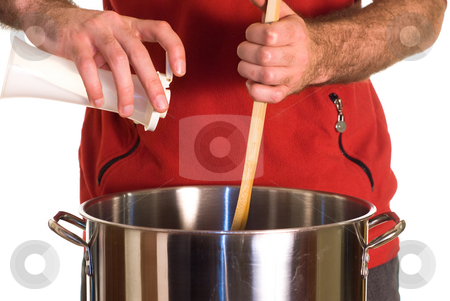 Salty Soup stock photo, Closeup view of someone adding some salt to a pot of soup by Richard Nelson