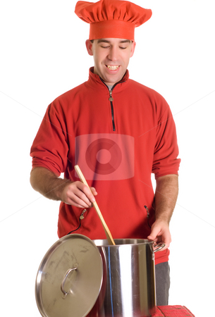Christmas Soup stock photo, A man wearing his Christmas Chef outfit making a pot of soup, isolated against a white background by Richard Nelson