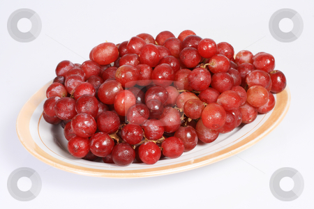 Red grapes stock photo, A plate of grapes isolated on white background by Jonas Marcos San Luis