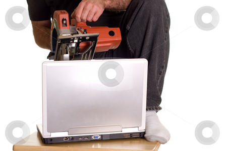 Computer Crash stock photo, A man about to kill his computer with a power saw because it crashed by Richard Nelson