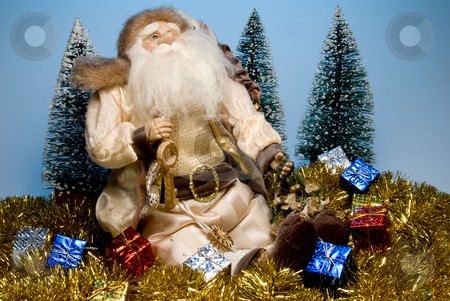 Santa Claus stock photo, Santa Claus surounded by holiday Christmas gifts. by Robert Byron