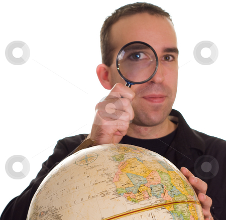 Looking stock photo, A man looking through a magnifying glass by Richard Nelson