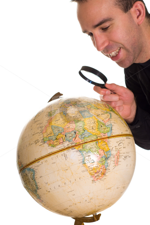 Finding My Town stock photo, A man looking at the globe to find the town he lives in by Richard Nelson