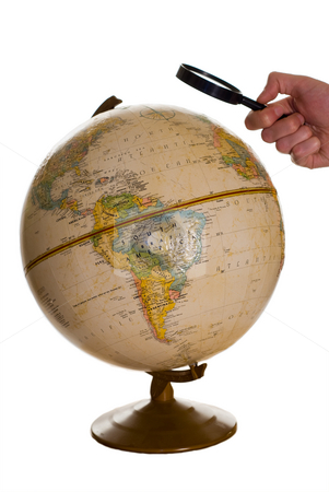 Looking Closely stock photo, Someone using a magnifying glass to look at the globe, isolated against a white background by Richard Nelson