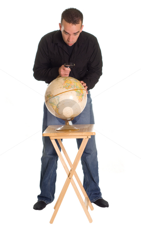 Planet Earth stock photo, A young man using a magnifier to look at a model of the planet earth by Richard Nelson