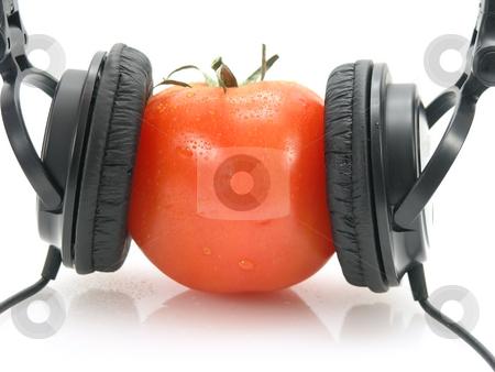 Tomato with headphones stock photo, Tomato with headphones by John Teeter