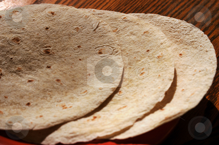 Tortilla shells stock photo, Tortilla shells on a table ready for filling by Tim Markley