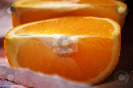 Orange quarters stock photo, Orange quarters on a paper towel ready to eat by Tim Markley