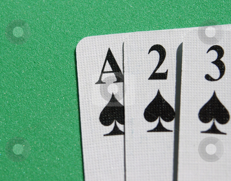 Spades in a row stock photo, Ace,two,three of spades in a row on a green background by Tim Markley