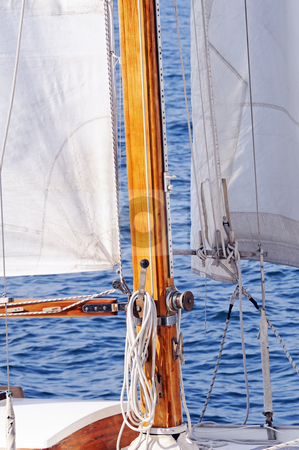 Wooden boat stock photo, Detail of a wooden mast and sail of a boat navigating by Massimiliano Leban