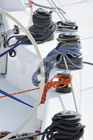 Sailboat stock photo, Detail of a sailboat with winches and ropes by Massimiliano Leban
